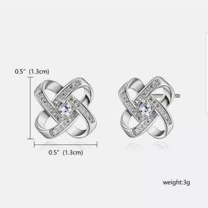 New silver toned CZ ear stud earrings halo flower
